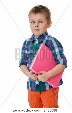 Fair-haired little boy holding under his arm a thick book, he go