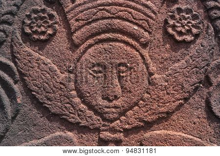 Angel face carved in red sandstone.