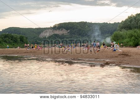 Russians Enjoying Nature And A River