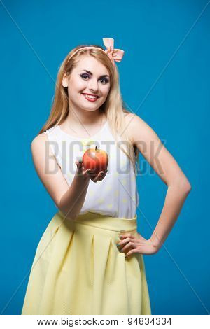 girl style of pin-up,  plays with apple, healthy lifestyle