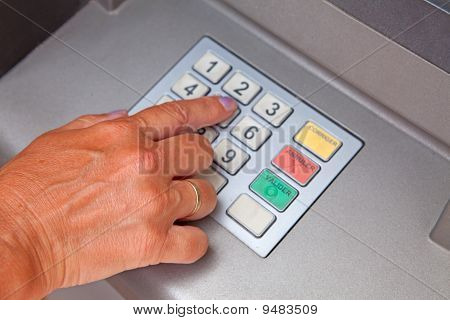 Entering Personal Identification Number On Atm Dial Panel