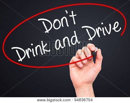 Man Hand writing Don't Drink and Drive with black marker on visual screen.