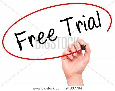 Man Hand writing Free Trial with black marker on visual screen.