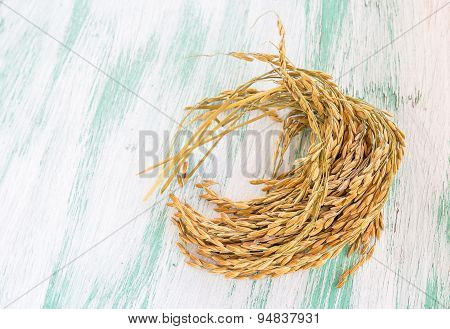 Paddy Rice Seed On Wooden Background