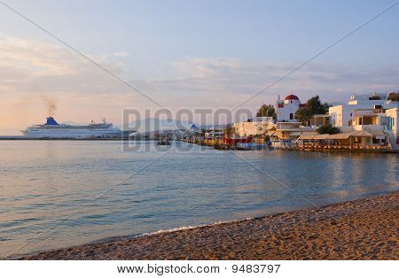 Sunset On Mykonos Island - The Ship In Port, A Famous Tavern And A Church ...