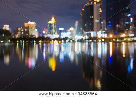 Blur bokeh city light at night with water reflection