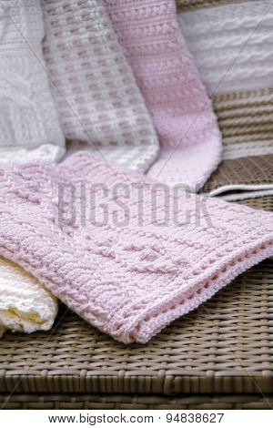 Crochet, Cable Knit Baby Blanket in Pink Color on Sofa