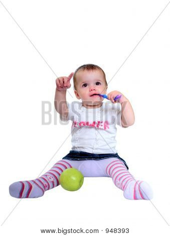 Young Baby Girl Brushing Teeth And Fresh Green Apple
