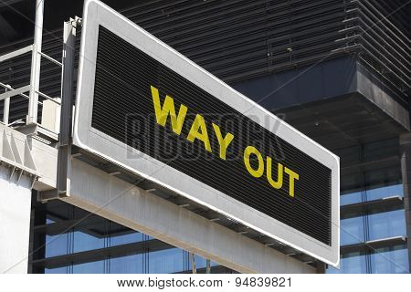 Way Out Signpost In The City With Building Facade Background