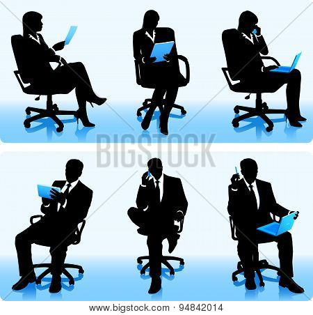 Businessmen in chairs