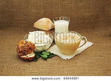 Fresh Dairy Products And Bread On Burlap Background.