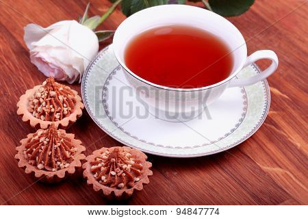 Cup Of Tea With Cake On Wood Table