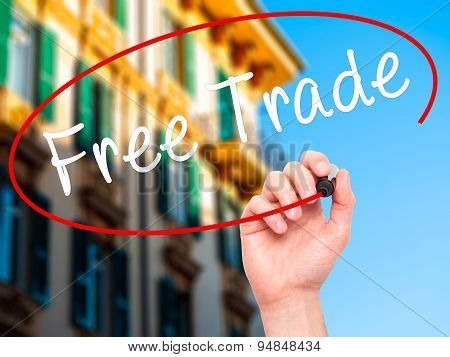 Man Hand writing Free Trade with black marker on visual screen.