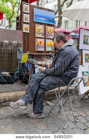 Street Artist Drawing A Picture At Montmartre, Paris, France