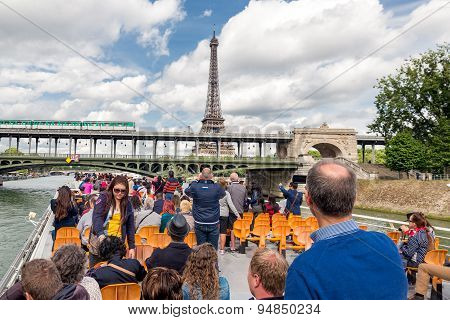 Tourists At River Cruise Admiring Eiffel Tower Paris