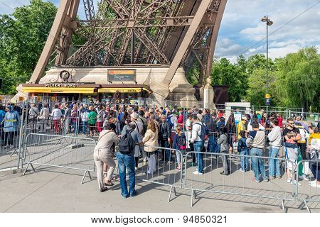 Tourists Waiting Near A Ticket Office Of The Eiffel Tower, Paris