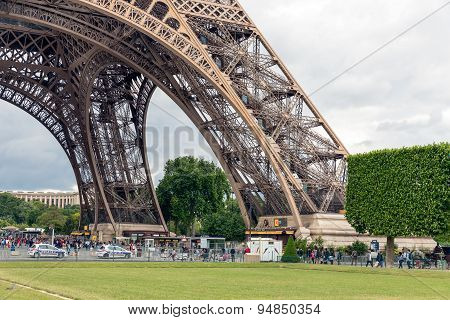 Tourists Near Eiffel Tower And Champ De Mars In Paris, France