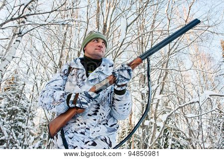 Hunter With A Gun In Hand In Winter