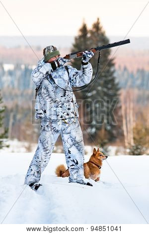 Hunter With Finnish Spitz In Winter