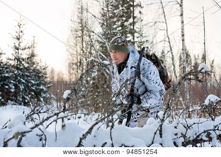 The Hunter Hides In The Winter Forest