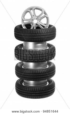 A Stack Of Car Wheels And Tires.