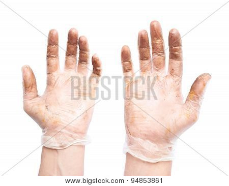 Worker's hands in a dirty gloves isolated