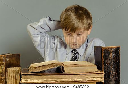 boy student studying old books