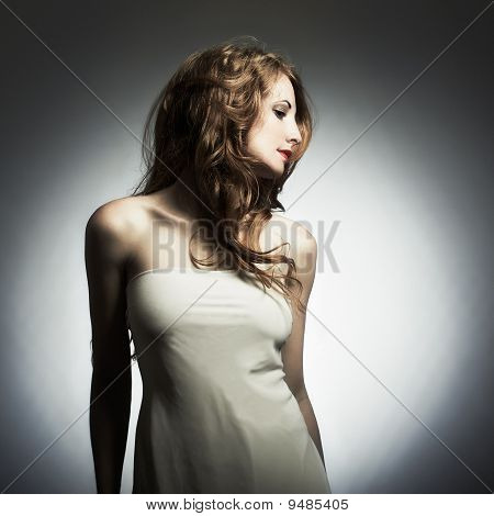 Fashion Portrait Of Young Woman In Studio