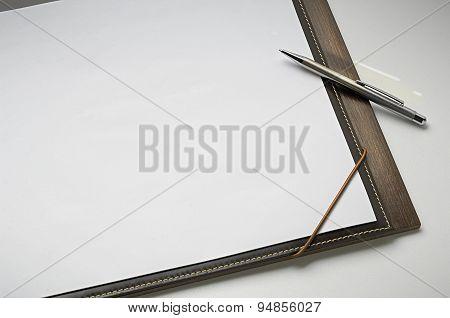 sketchbook with pen