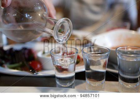 Person Pouring Vodka