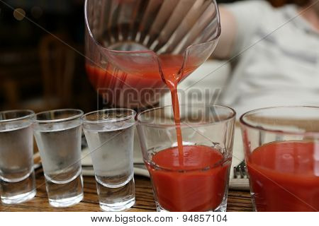 Person Pouring Tomato Juice