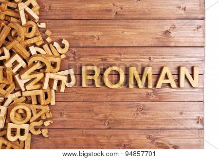 Word roman made with wooden letters