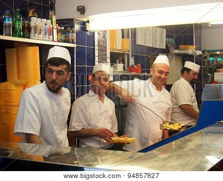 Takeaway staff working in the kitchen