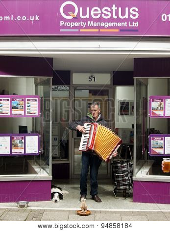 Street musician plays accordion
