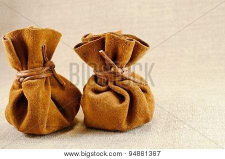 Two Bags Of Suede