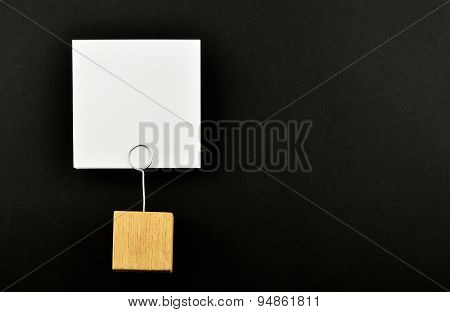 One Paper Note With Holder On Black Background For Presentation