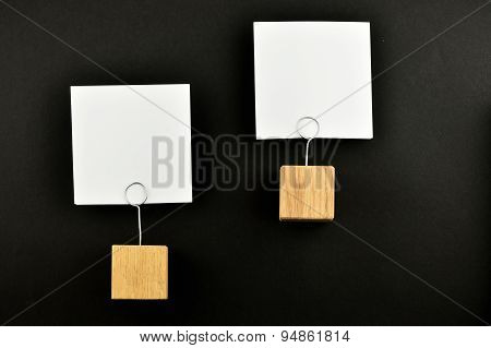 Two Paper Notes With Holders On Black Background For Presentation