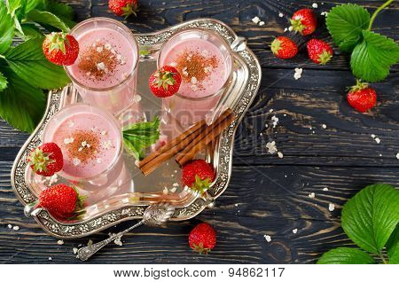 Strawberry Smoothie On A Wooden Table