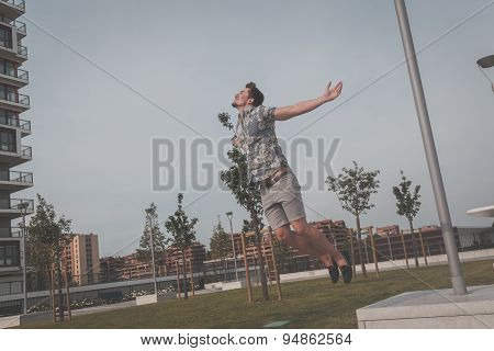 Young Handsome Man Jumping In The Street