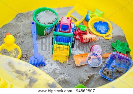 Colorful Sand Toys In Sandbox