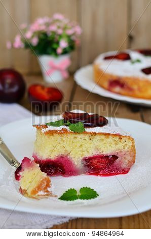 Plum Cake On Wooden Table