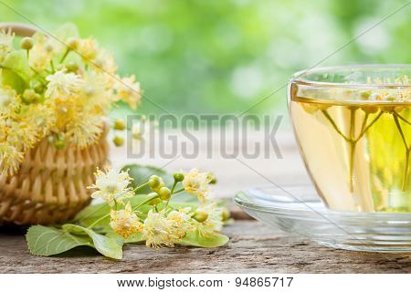 Cup Of Linden Tea And Wicker Basket With Lime Flowers, Herbal Medicine.