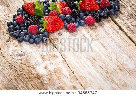 Fruit On Wooden Background.