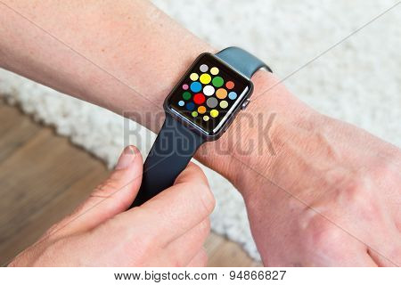 Hand wearing elegant smartwatch with clock app