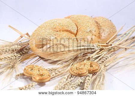 Roll From Wheat Flour Of A House Batch On A White Background