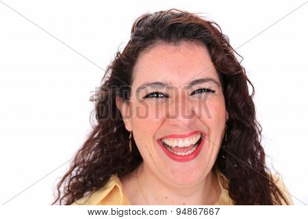 Face Forward Headshot Of A Laughing Spanish Female With Dark Hair
