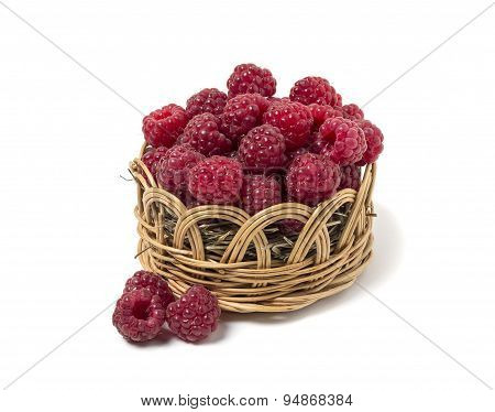 Raspberry In A Wicker Basket. Isolated On White Background