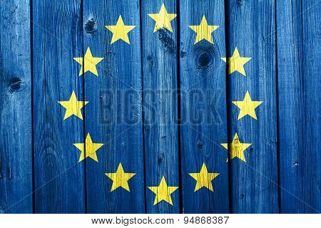 European Union Flag In The Background Of An Old Cracked Wooden Texture