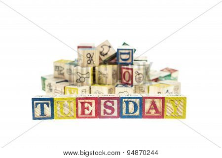 Tuesday Written In Letter Colorful Alphabet Blocks Isolated On White