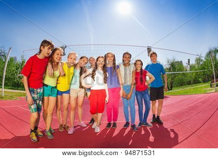 Row of teenagers who stand on volleyball court